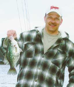 Tony Sprouse from Advance displays a nice-size Badin crappie. Crappie usually hold at 10 to 12 feet when the water temperature rises to 50 degrees.