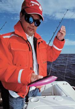 It takes a big rod to troll big lures for kings, and anglers also never know when a wahoo or tuna will strike. Ng uses trolling rods with electric-assist reels when exploring for kings while running at fast speeds.