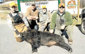 These hunters bagged this 280-pound boar in Oconee County. Wild hogs have been found in 42 of the 46 counties in South Carolina.