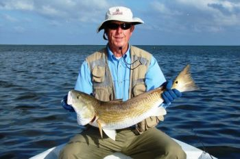 Taylor Ryan of Southport, with a healthy overslot redfish.  With the regulations of the Red Drum Fishery Management Plan, the numbers of North Carolina redfish continue to slowly grow.