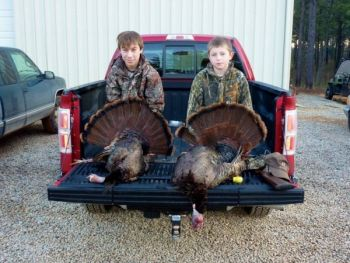 Morgan Levy and Thomas Maness with their youth turkey hunt toms