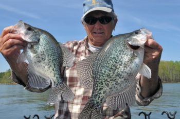 Bud Haynes of Clarksville, Va., mines crappie treasures from �trash� in Kerr Lake.