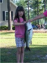 Mackenzie Mills and her lunker largemouth