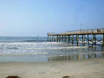 This is what remains of the Sheraton Pier in Atlantic Beach. The pier had lost roughly half its length from a hurricane several years ago, and extended a little past where the lone piling stands when Hurricane Irene hit.