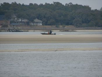 A skiff navigates the sand bars in Lockwood Folly Inlet between Oak Island and Holden Beach. Severe shoaling menas the Coast Guard will remove channel buoys until dredging can begin.