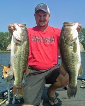 Jeff Thomas displays 9- and 11-pound largemouths he caught this spring.