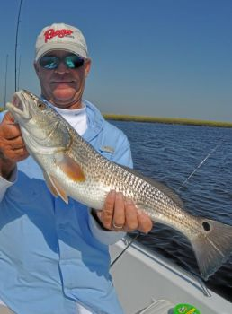 Jeff Wolfe of Wilmington is on top of a slot red drum bite at the bays north of Bald Head Island.