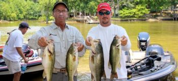 David Wright and Chris Brown of Lexington won the June 30 Yadkin Team Trail event on High Rock with this 19.99-pound catch that included the day�s big bass at 6.61 pounds.