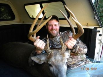 An Iredell County hunter has won the November Bag-A-Buck contest with his entry of this tall, heavy 8-point buck.