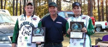 Bass pro Davy Hite congratulates J.T. Rawski (left) and Ben Stone, winners of the Junior Bassmaster State Championship, held Nov. 3 at Lake Greenwood.