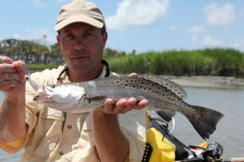 : Dalton Reames shows off the kind of healthy speckled trout that Bulls Bay anglers are catching regularly.<br />