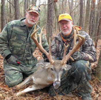 Robbie Bennett (right) poses with his Montgomery County 19-point buck and his father, O�Neill Bennett.