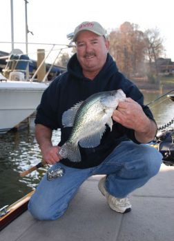 Former national champion crappie fisherman Mike Parrott sets his sights on boat docks for catching some slab crappie at Lake Wylie on the North Carolina-South Carolina border.