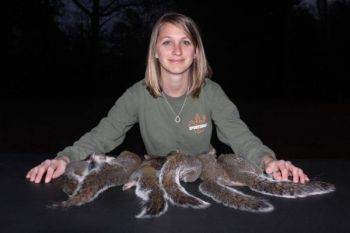Brooke Knott shows off a six-pack of squirrels from a recent hunt.