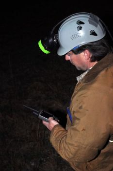 David MacCallum uses a GPS tracking collar to keep tabs on his dog�s progress during a raccoon hunt.