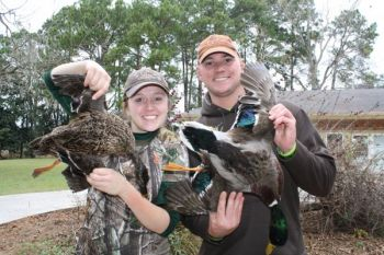 Ashleigh and Keith Peffer, Marines who participated in the Beaufort County DU chapter's Warriors Hunt, show off two of the ducks they harvested.