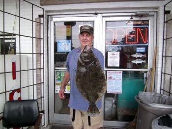 Big flounder are really starting to show up in Southport's inshore waters, with plenty of bait already around.