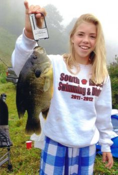 A 13-year-old Charlotte girl's catch of a huge green sunfish has been certified as a new state record.