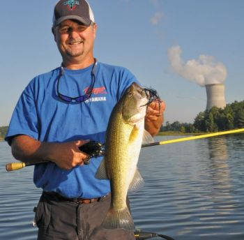 Guide Jeffrey Thomas has had a productive August catching schooling bass on top at Shearon Harris Lake, and catching an occasional big fish on a jig in deep water.
