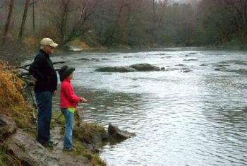 The author supervises his granddaughter on a trip to the Tuckasegee River upstream from the delayed-harvest section.