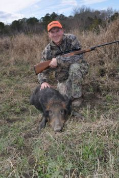The author shows off a nice hog he took on from public land along South Carolina's Waccamaw River.