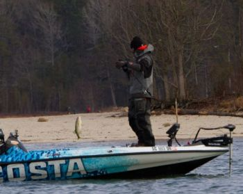 Casey Ashley of Donalds puts a Lake Hartwell bass in his boat in the Bassmaster Classic.