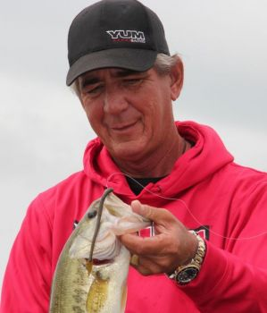 Zell Rowland holds up a bass caught on the YUM Sharp Shooter.