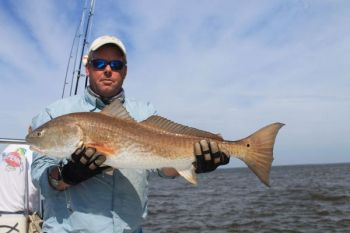 Go slow and go light when targeting redfish in extremely shallow, clear water.