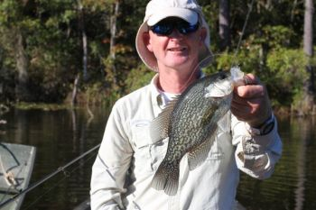 Crappie like this one are biting minnow-tipped jigs and Beetlespins