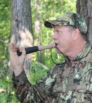 Steve Cobb uses an HS Slam Talker to make the sounds of a buck�s grunt-wheeze warning call.