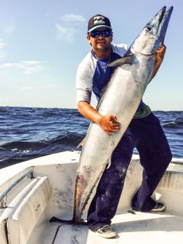Filipe Balbino had to whip an inexperienced crew into shape quickly to land this 98-pound wahoo out of Carolina Beach.