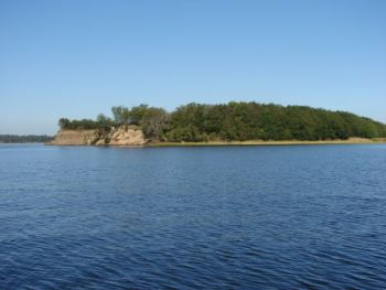Spoil islands in the Cape Fear, like this one, are constantly changing in size and shape as the river channel is dredged and the tidal flow is altered.