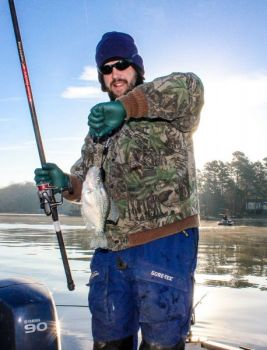 Warmer weather might move crappie up and into brush piles, where deep-jigging with a single curlytail is productive.