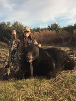 Katlyn Williams shot this 645-pound black bear in Washington County the day after killing her first deer.