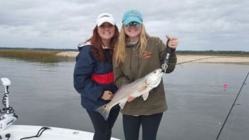 Andrea and Abbi Jordan show off a nice lowcountry redfish they caught recently with Capt. Rick Percy of Reel Chance Charters.