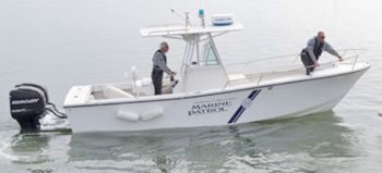 Marine Patrol Officers Justin Lott, Chris Lee, and Amos Williams helped pluck a waterfowl hunter from the chilly Roanoke Sound after the hunter's boat got away from him.