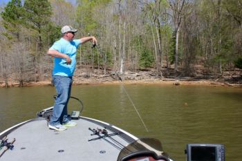 Flipping or pitching is a great way to get a jig or Texas-rigged soft-plastic bait back into shoreline cover like bushes.