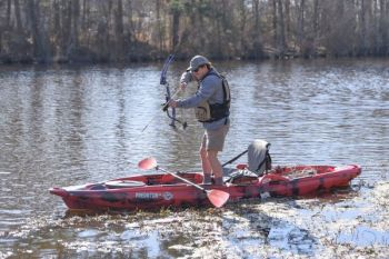 A kayak is a great platform for bowfishing shallows.