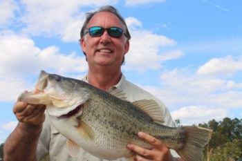 Dave Miller shows off the 12 1/2-pound bass he caught over the weekend in a lowcountry pond.