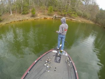 With the angler in the front deck of a bass boat concentrating on bedding bass on the bank, an angler on the back deck has the rest of a pocket to fish.