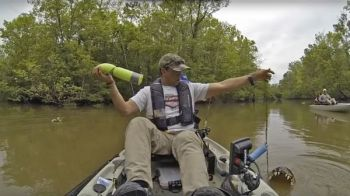 Baton Rouge's Lance Burgos and his daughter Evan, seated behind her father, was curious about what had taken a jug line and pulled up a 12- to 14-foot alligator during a kayak trip to Lake Fausse Point State Park on April 9.