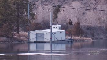 This is a daylight shot of a work barge moored about 200 yards from the Binox unit.