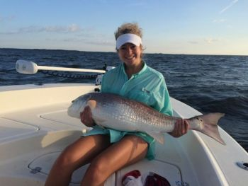 Big fish like this bull redfish caught on a trip with Capt. Ponytail Charters are easier to handle at the boat if you turn them upside down, says veteran guide Rod Thomas.