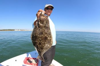 Capt. Dennis Barbour poses with a nice flounder he caught along the southern coast of North Carolina.