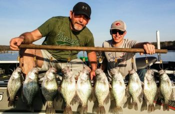 Hot weather and hot crappie fishing go together at Kerr Lake, at least for guide Keith Wray, who concentrates on deep brush piles.