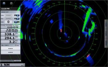 This screen shot shows Furuno's Target Analyzer engaged and indicating two red targets approaching. The Echo Trail feature shows the shadowy paths of the moving objects to help avoid the vessels.