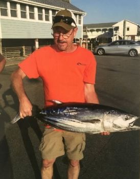 Tim Street poses with the new North Carolina state record skipjack tuna he caught on May 24.