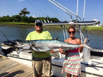 Kathryn McClure and Cory Swink pose with the 66-pound king mackerel that McClure caught last week out of Holden Beach.