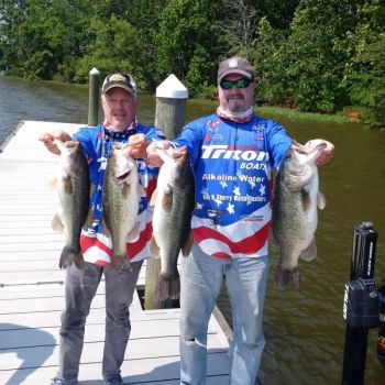 Setting the hook at the right time will help you land more topwater bass like these from Marc Deschenes and Ray Walsh.