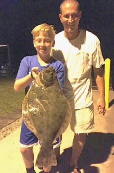 These two outdoorsmen had a big night of gigging with Capt. Allen Jernigan of Breadman Ventures, gigging a 7-pound flounder, and one with a genetic anomaly.